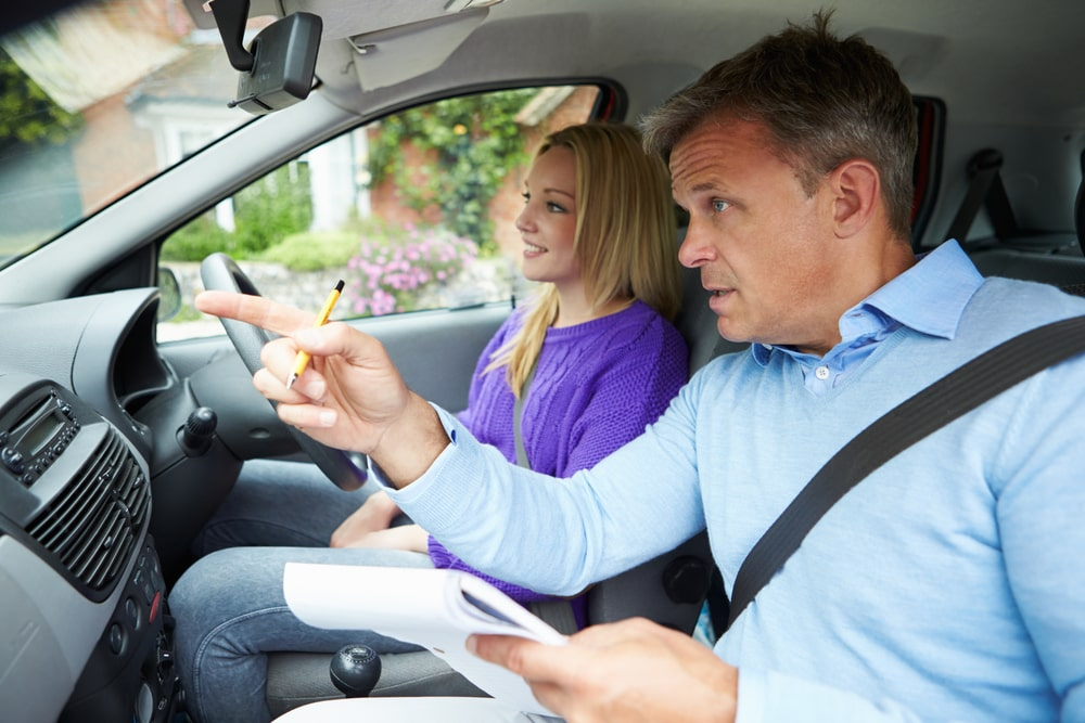 can i take driving instructir to driving test